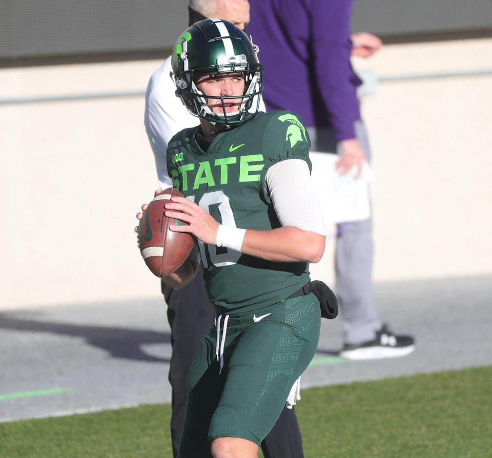 Michigan State quarterback Payton Thorne warms up before the game against Northwestern at Spartan Stadium Saturday, Nov. 28, 2020.
