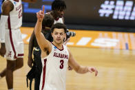 Alabama forward Alex Reese (3) waves to fans as he leaves the court following a first-round game against Iona in the NCAA men's college basketball tournament at Hinkle Fieldhouse in Indianapolis, Saturday, March 20, 2021. Alabama defeated Iona 68-55. (AP Photo/Michael Conroy)