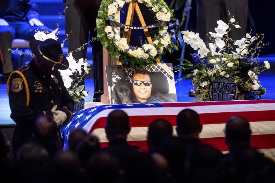"""FILE - In this Jan. 5, 2019, file photo, a picture of slain Newman police Cpl. Ronil """"Ron"""" Singh rests atop the casket during his funeral in Modesto, Calif. Paulo Virgen Mendoza, a Mexican, national pleaded guilty under a deal with prosecutors to killing the immigrant California police officer in a case that President Donald Trump used to bolster his call for tougher border security. Mendoza on Thursday, Nov. 5, 2020, admitted fatally shooting Singh during a traffic stop early the day after Christmas in 2018. (AP Photo/Noah Berger, File)"""