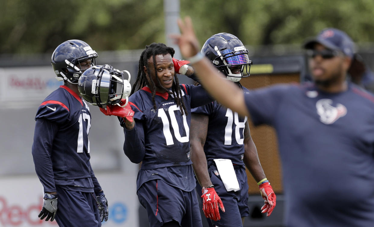 Houston Texans receiver DeAndre Hopkins (C) and San Francisco 49ers corner Jimmie Ward got into a fight at practice on Wednesday. (AP)