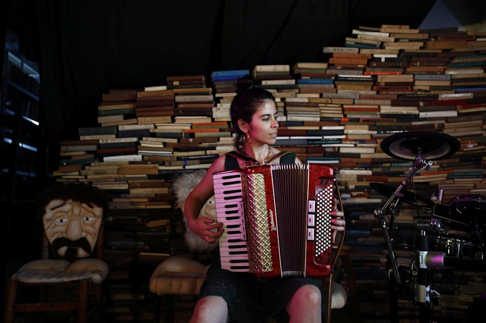 Tamar Lehman, a social counselor for mentally ill young adults, plays an accordion inside a cultural center used by Yung Yidish, a nonprofit group aiming to preserve Yiddish culture, at the Central Bus Station on May 25.  (Photo: Corinna Kern/Reuters)