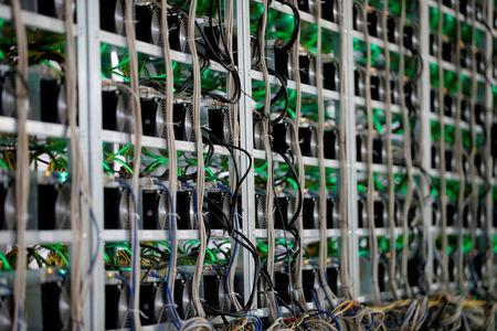 FILE PHOTO: Cryptocurrency miners are seen on racks at the HydroMiner cryptocurrency farming operation near Waidhofen an der Ybbs, Austria, April 25, 2018.   REUTERS/Leonhard Foeger/File Photo