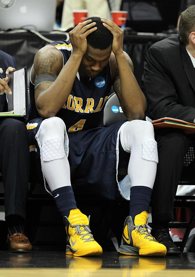 LOUISVILLE, KY - MARCH 17: Latreze Mushatt #4 of the Murray State Racers covers his head on the bench late in the game against the Marquette Golden Eagles during the third round of the 2012 NCAA Men's Basketball Tournament at KFC YUM! Center on March 15, 2012 in Louisville, Kentucky. (Photo by Andy Lyons/Getty Images)
