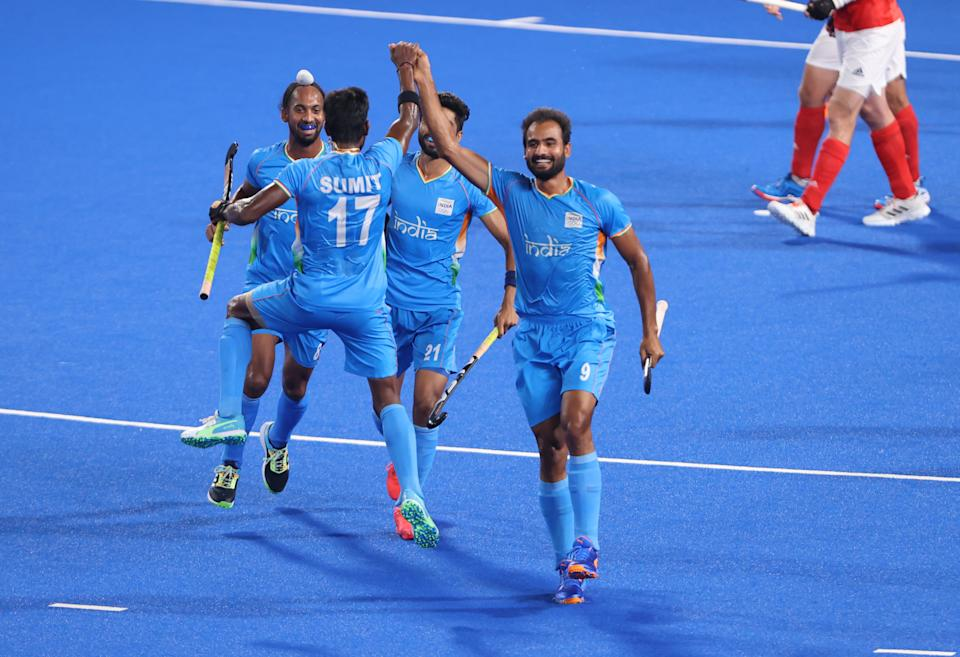 TOKYO, JAPAN - AUGUST 01: Gurjant Singh of Team India celebrates with teammates Sumit, Hardik Singh and Shamsher Singh after scoring their team's second goal during the Men's Quarterfinal match between India and Great Britain on day nine of the Tokyo 2020 Olympic Games at Oi Hockey Stadium on August 01, 2021 in Tokyo, Japan. (Photo by Alexander Hassenstein/Getty Images)