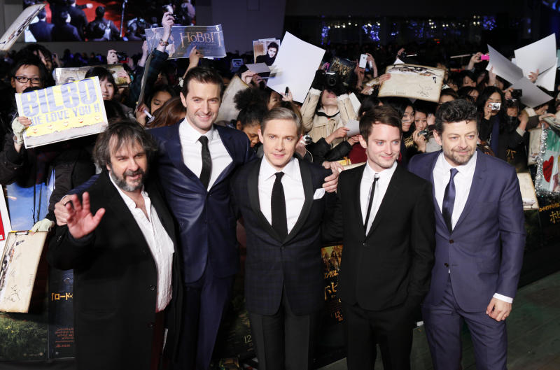 """FILE - In this Dec. 1, 2012 file photo, director Peter Jackson, left, and actors, from left, Richard Armitage, Martin Freeman, Elijah Wood and Andy Serkis, pose for photographers upon arrival for the Japan premiere of their film """"The Hobbit: An Unexpected Journey"""" in Tokyo. Many fans are eagerly anticipating a return to the fictional world of Middle-earth with next week's general release of the first movie in """"The Hobbit"""" trilogy, the precursor to """"The Lord of the Rings"""" movies. (AP Photo/Koji Sasahara, File)"""