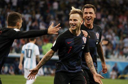 Soccer Football - World Cup - Group D - Argentina vs Croatia - Nizhny Novgorod Stadium, Nizhny Novgorod, Russia - June 21, 2018 Croatia's Ivan Rakitic celebrates scoring their third goal with Mateo Kovacic and Mario Mandzukic REUTERS/Lucy Nicholson