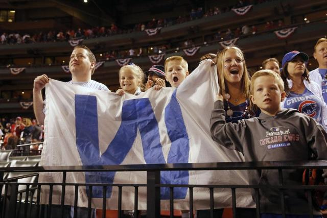 Cubs fans fly the 'W' flag during a playoff game in 2016. (AP)