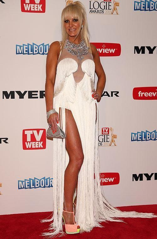US socialite - and former wife to Geoffrey - Brynne Edelsten is known for her daring red carpet choices but this look from the 2013 Logies might take the cake. There's just so much going on, from the fringing to the thigh-high split, neck embellishment and mesh panelling. The neon pink heels look like they were thrown on at the last minute, too. Photo: Getty Images.