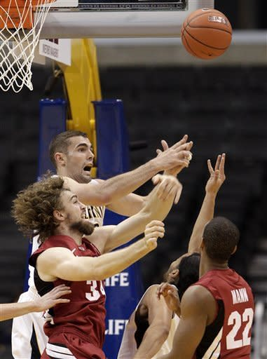California's Harper Kamp, top left, and Stanford 's Andrew Zimmermann fight for a rebound during the first half of an NCAA college basketball game at the Pac-12 conference championship in Los Angeles, Thursday, March 8, 2012. (AP Photo/Jae C. Hong)