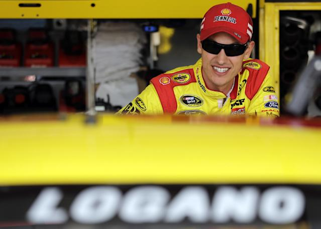 Driver Joey Logano looks from his garage during practice for the NASCAR Sprint Cup Series auto race at Chicagoland Speedway in Joliet, Ill., Friday, Sept. 13, 2013. (AP Photo/Nam Y. Huh)