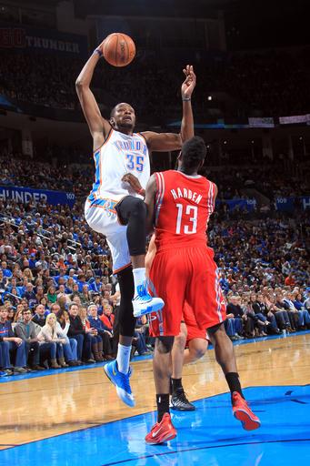 OKLAHOMA CITY, OK - DECEMBER 29: Kevin Durant #35 of the Oklahoma City Thunder shoots over James Harden #13 of the Houston Rockets during an NBA game on December 29, 2013 at the Chesapeake Energy Arena in Oklahoma City, Oklahoma. (Photo by Layne Murdoch/NBAE via Getty Images)