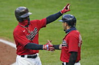 Cleveland Indians' Francisco Lindor, left, is congratulated by Cesar Hernandez after Lindor hit a two-run home run during the third inning of the team's baseball game against the Kansas City Royals, Tuesday, Sept. 8, 2020, in Cleveland. (AP Photo/Tony Dejak)