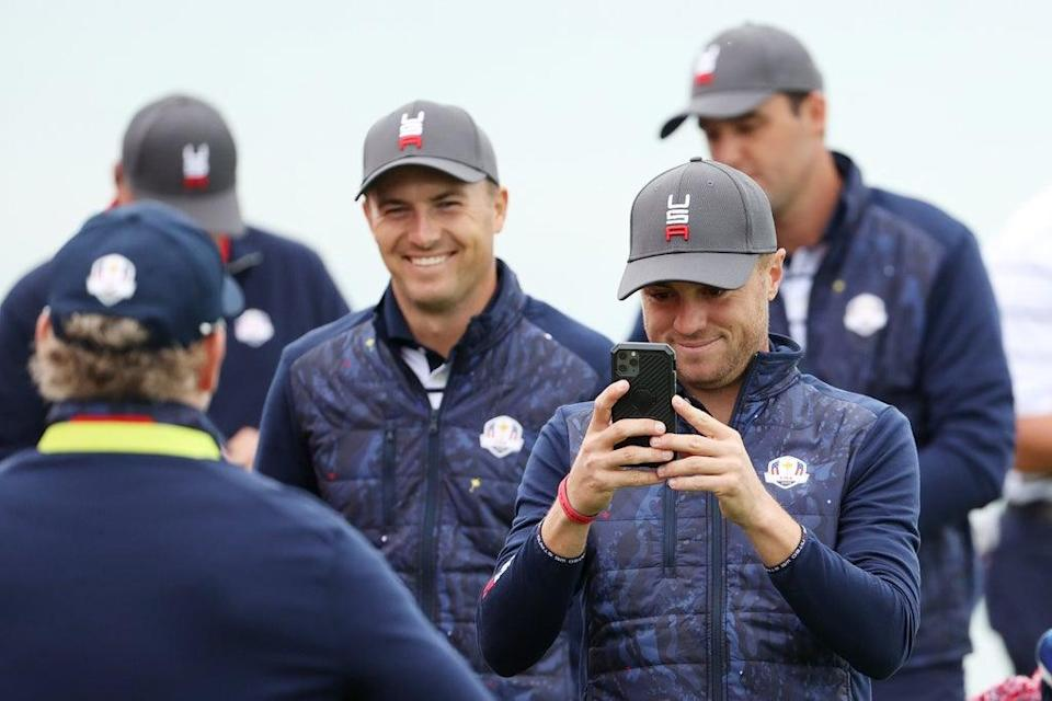 Jordan Spieth of team United States (L) and Justin Thomas of team United States take photos on the third green (Getty)