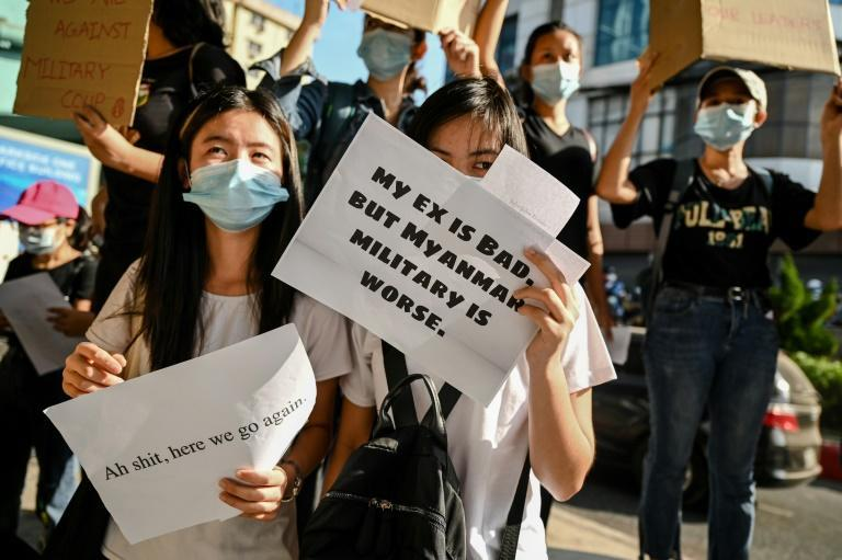 Myanmar protesters are denouncing the military coup with humorous signs that have been shared widely on social media