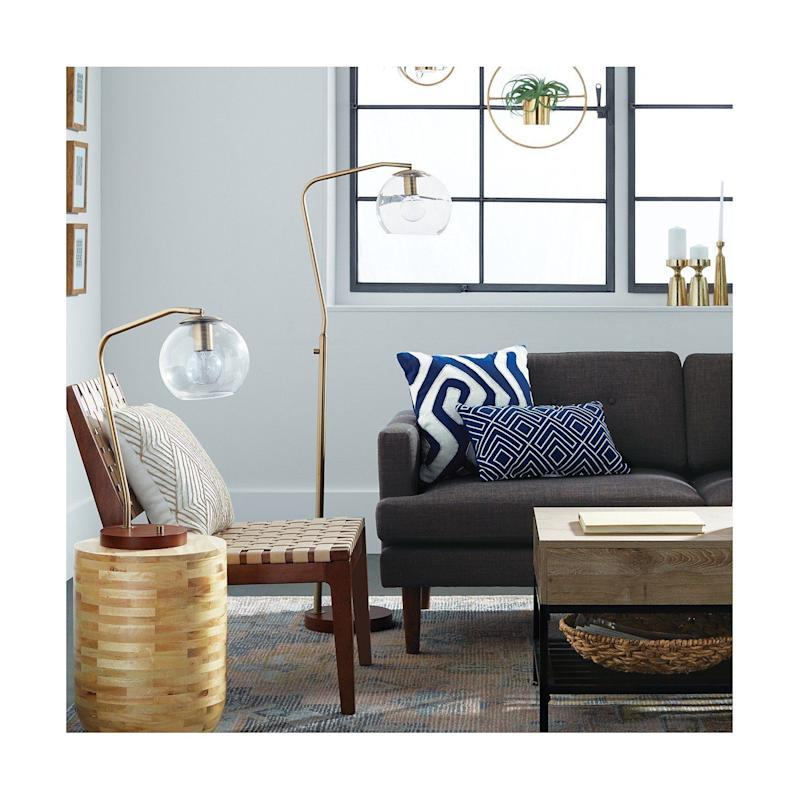 """<a href=""""https://www.target.com/p/madrot-glass-globe-floor-lamp-project-62-153/-/A-52937601#lnk=newtab"""" target=""""_blank"""">Shop it here</a>."""