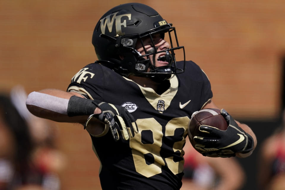 Wake Forest wide receiver Taylor Morin celebrates after scoring against Louisville during the first half of an NCAA college football game on Saturday, Oct. 2, 2021, in Winston-Salem, N.C. (AP Photo/Chris Carlson)
