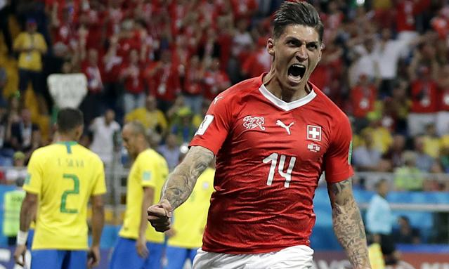 Switzerland's Steven Zuber celebrates after scoring but the goal was hotly contested by Brazil's manager.