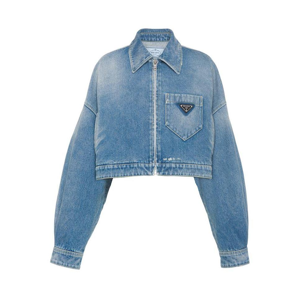 """<p><strong>Prada</strong></p><p>prada.com</p><p><strong>$1450.00</strong></p><p><a href=""""https://www.prada.com/us/en/women/ready_to_wear/denim/products.cropped_organic_denim_jacket.GFB279_1ZAB_F0008_S_212.html"""" rel=""""nofollow noopener"""" target=""""_blank"""" data-ylk=""""slk:Shop Now"""" class=""""link rapid-noclick-resp"""">Shop Now</a></p><p>A denim jacket is a no-brainer item to pack, but upgrade them to Prada and you'll see it all over their Instagram Stories. </p>"""