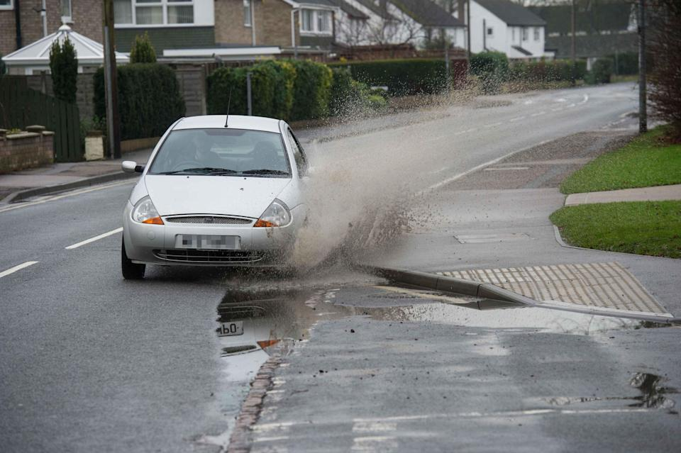 The car (not pictured) splashed a mother and her two children (SWNS)