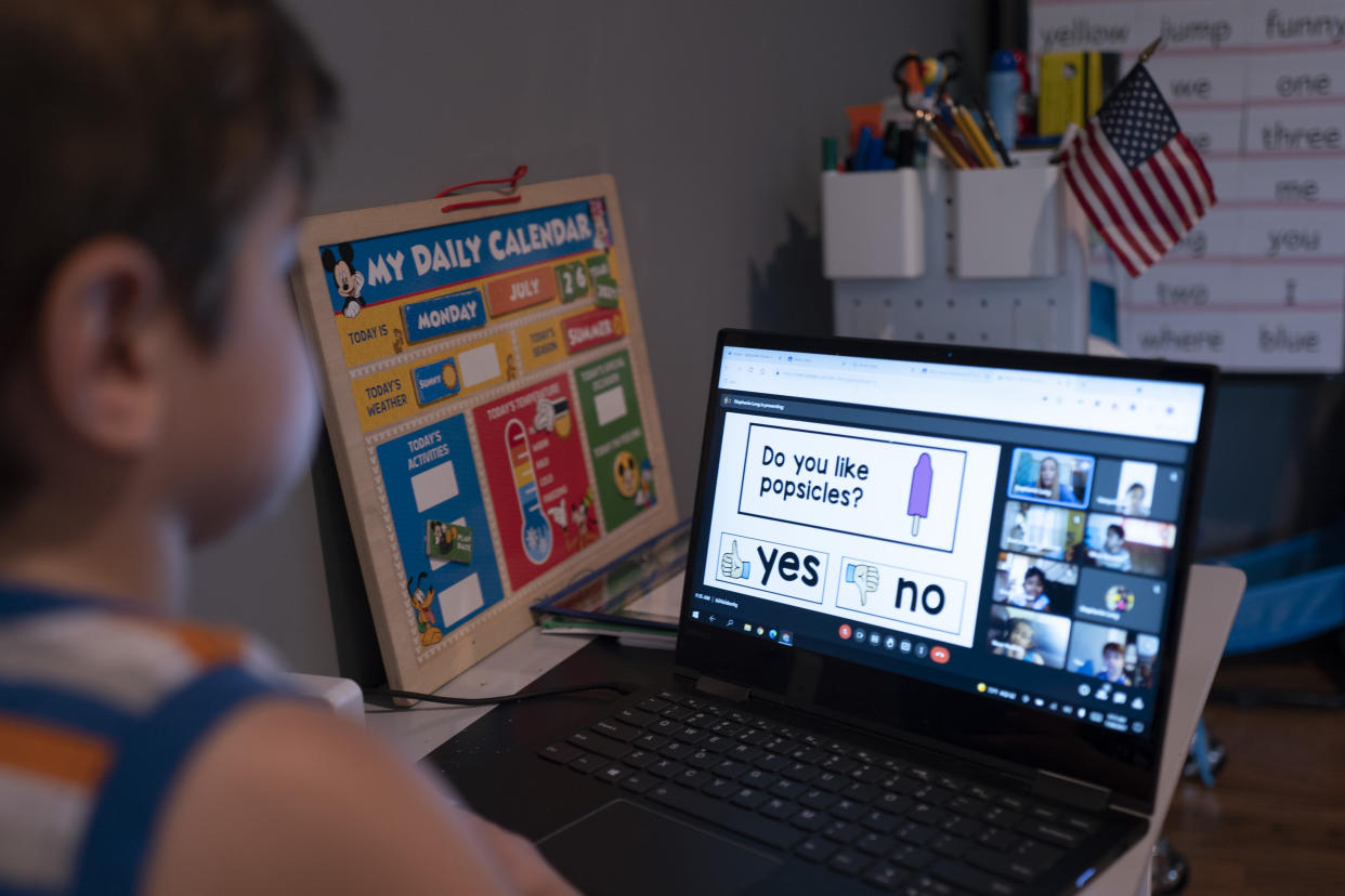 Logan Strauss, 5, participates in an online class from home in Basking Ridge, N.J., in July. Logan's parents are keeping him out of school until he is able to get the COVID-19 vaccine.