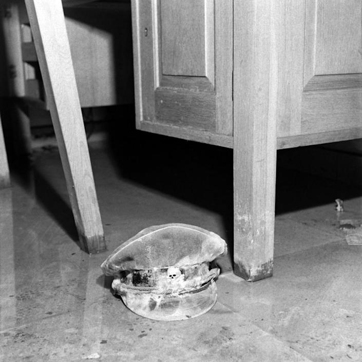 """Unpublished: An SS officer's cap, with the infamous """"death's head"""" skull emblem barely visible. Of this image, Vandivert's notes state simply: """"moldy SS cap lying in water on floor of sitting room."""" (William Vandivert—Time & Life Pictures/Getty Images) <br> <br> <a href=""""http://life.time.com/history/inside-hitlers-bunker-rare-and-unpublished-photos/#1"""" rel=""""nofollow noopener"""" target=""""_blank"""" data-ylk=""""slk:Click here"""" class=""""link rapid-noclick-resp"""">Click here</a> to see the complete collection of pictures and read the full story at LIFE.com"""