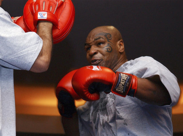 FILE - In this Aug. 30, 2006, file photo, former heavyweight boxing champion Mike Tyson spars during a training exhibition in Las Vegas. Tyson hasn't announced any plans to return to the ring, though he did suggest on an Instagram post he might make himself available for 3 or 4-round exhibitions if the price was right. And already some people in Australia are talking about offering him $1 million to fight an exhibition against a rugby star or two. (AP Photo/Marlene Karas, File)