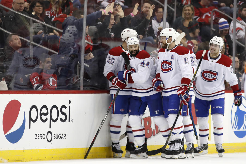 Montreal Canadiens center Nate Thompson (44) is congratulated for his goal during the second period of the team's NHL hockey game against the New Jersey Devils, Tuesday, Feb. 4, 2020, in Newark, N.J. (AP Photo/Kathy Willens)
