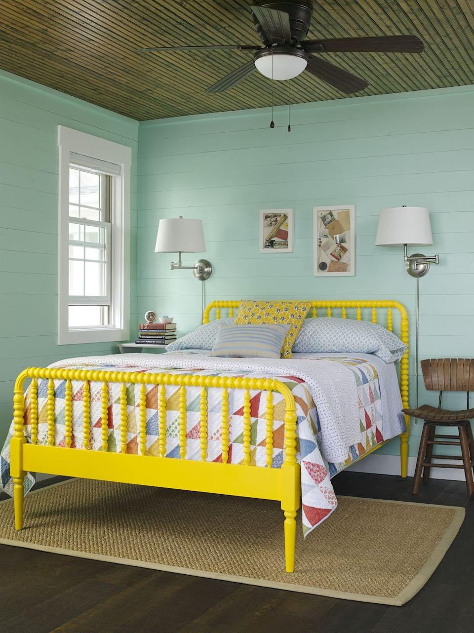 """<p>A beach house or lake cottage is a place to kick back and have fun, so choose a color palette that reflects that sentiment. Seafoam green and school bus yellow may <em>sound</em> over the top, but the duo actually works in this bedroom because the """"cool"""" wall color takes the edge off of the """"hot"""" bed frame. Choosing a quilt or comforter that features both tones bridges the gap. </p><p><strong>Get the Look: </strong><br>Wall Paint Color: <a href=""""https://store.benjaminmoore.com/storefront/index.ep"""" rel=""""nofollow noopener"""" target=""""_blank"""" data-ylk=""""slk:Sea Mist Green by Benjamin Moore"""" class=""""link rapid-noclick-resp"""">Sea Mist Green by Benjamin Moore<br></a>Bed: <a href=""""https://go.redirectingat.com?id=74968X1596630&url=https%3A%2F%2Fwww.wayfair.com%2Fbaby-kids%2Fpdp%2Flittle-seeds-rowan-valley-panel-bed-w002966713.html&sref=https%3A%2F%2Fwww.countryliving.com%2Fremodeling-renovation%2Fhome-makeovers%2Fg32468539%2Fbest-bedroom-paint-colors-ideas%2F"""" rel=""""nofollow noopener"""" target=""""_blank"""" data-ylk=""""slk:Jenny Lind Bed; wayfair.com"""" class=""""link rapid-noclick-resp"""">Jenny Lind Bed; <em>wayfair.com</em></a></p>"""