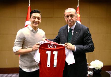 FILE PHOTO: Turkish President Erdogan meets with Arsenal's soccer player Ozil in London