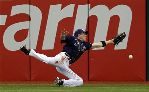 Tampa Bay Rays left fielder Rich Thompson dives but can't get an eighth-inning double by Toronto Blue Jays' Jose Bautista during a baseball game, Wednesday, May 23, 2012, in St. Petersburg, Fla. (AP Photo/Chris O'Meara)