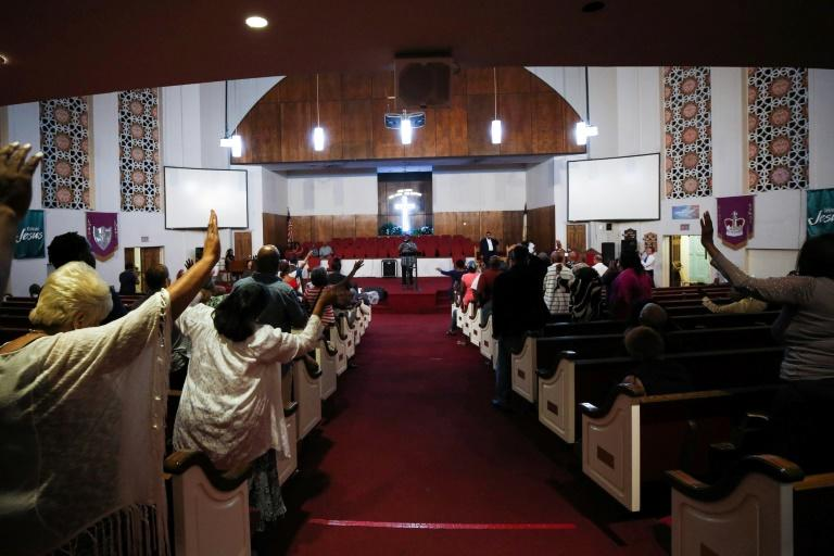 People pray at a morning service for singer Aretha Franklin at the New Bethel Baptist Church on August 15, 2018 in Detroit, Michigan