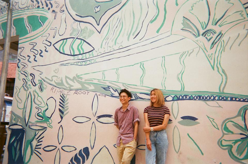 Ripple Root posing in front of their mural. (PHOTO: Ripple Root)
