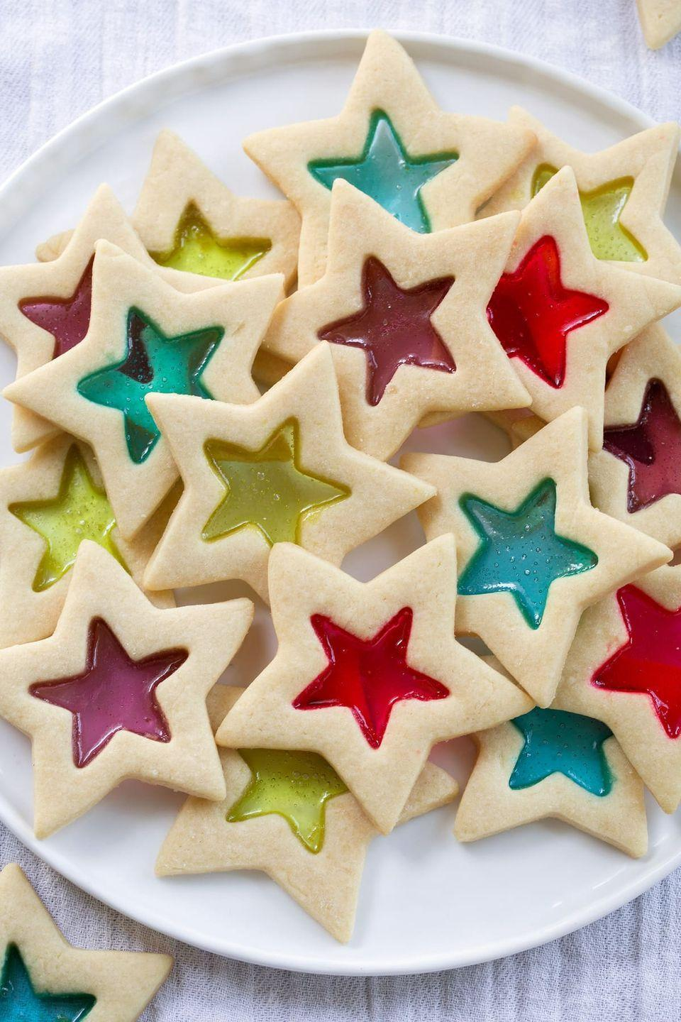 """<p>These cookies are reminiscent of the stained glass windows at church on Christmas morning—and they're so much easier to make than you think.</p><p><strong>Get the recipe at <a href=""""https://www.cookingclassy.com/stained-glass-cookies/"""" rel=""""nofollow noopener"""" target=""""_blank"""" data-ylk=""""slk:Cooking Classy"""" class=""""link rapid-noclick-resp"""">Cooking Classy</a>.</strong></p><p><a class=""""link rapid-noclick-resp"""" href=""""https://www.amazon.com/JOLLY-RANCHER-Holiday-Candy-Assortment/dp/B004YGQK5K/?tag=syn-yahoo-20&ascsubtag=%5Bartid%7C10050.g.647%5Bsrc%7Cyahoo-us"""" rel=""""nofollow noopener"""" target=""""_blank"""" data-ylk=""""slk:SHOP HARD CANDIES"""">SHOP HARD CANDIES</a></p>"""