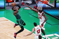 Boston Celtics guard Jaylen Brown (7) takes a shot against Chicago Bulls forward Patrick Williams (44) and forward Garrett Temple (17) during the first half of an NBA basketball game, Monday, April 19, 2021, in Boston. (AP Photo/Charles Krupa)