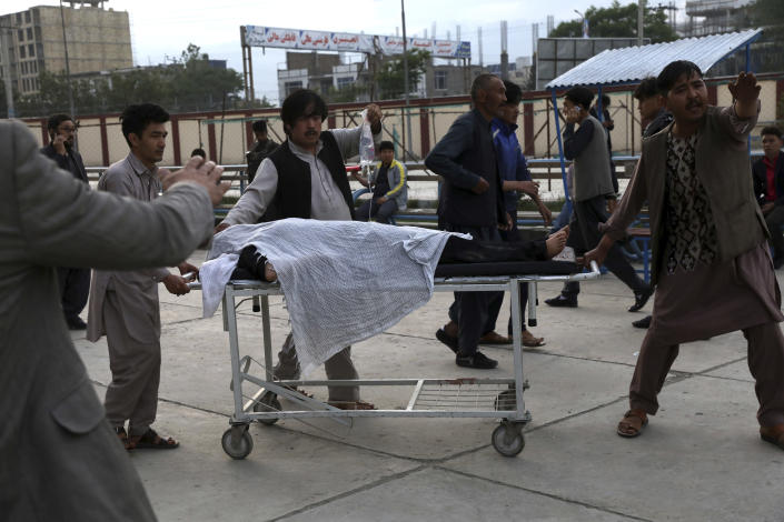 An injured school student is transported to a hospital after a bomb explosion near a school in west of Kabul, Afghanistan, Saturday, May 8, 2021. A bomb exploded near a school in west Kabul on Saturday, killing several people, many them young students, an Afghan government spokesmen said. (AP Photo/Rahmat Gul)