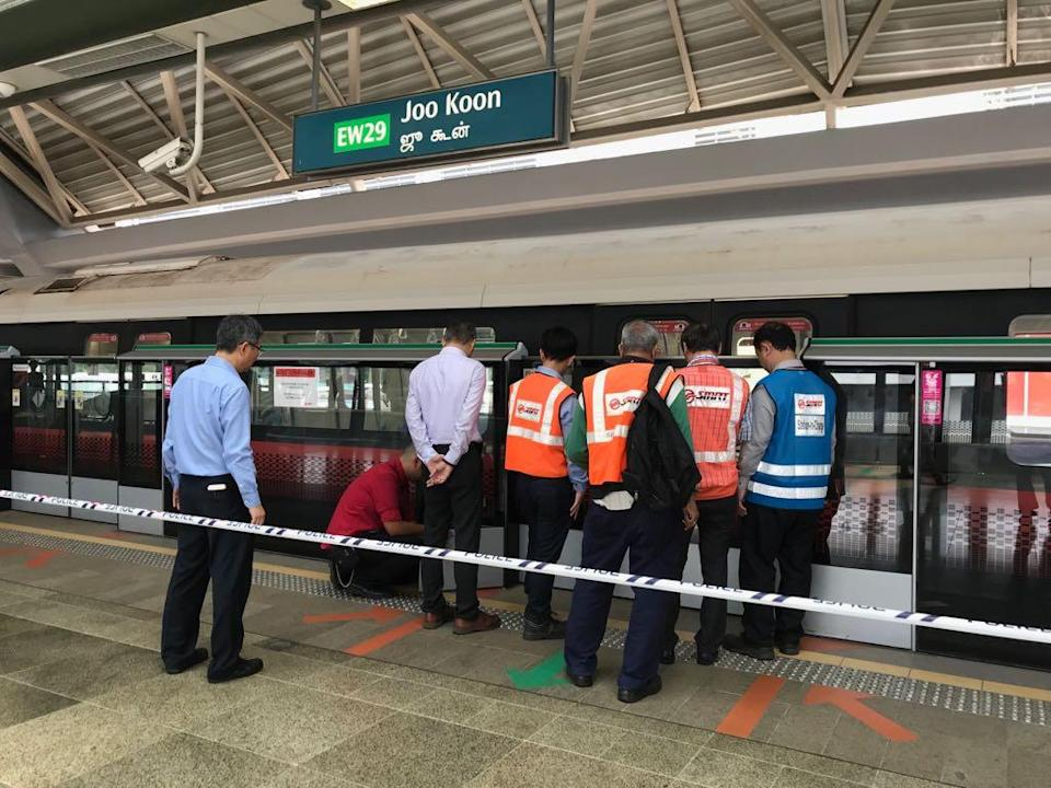 SMRT staff inspecting at a platform of Joo Koon station on the morning of 15 November 2017 after a moving train hit a stationary train at the station, causing injuries to 28 persons. (PHOTO: Hannah Teoh/Yahoo News Singapore)
