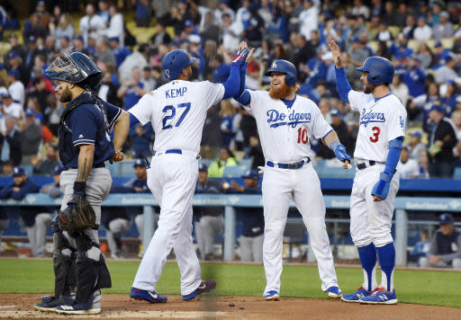 Los Angeles Dodgers' Matt Kemp, second from left, is congratulated by Justin Turner, second from right, and Chris Taylor after hitting a three-run home run as San Diego Padres catcher Raffy Lopez stands at the plate during the first inning of a baseball game Friday, May 25, 2018, in Los Angeles. (AP Photo/Mark J. Terrill)