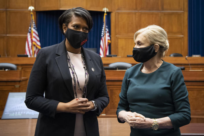 Washington Mayor Muriel Bowser and Chairwoman Carolyn Maloney talk at the end of the House Oversight and Reform Committee hearing on H.R.51 on Monday, March 22, 2021. / Credit: Caroline Brehman/CQ-Roll Call, Inc via Getty Images