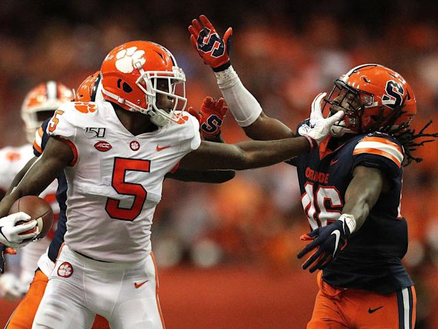 <p>Clemson's Tee Higgins grabs Syracuse's Lakiem Williams's face mask during a game at the Carrier Dome on Sept. 14, 2019.</p>