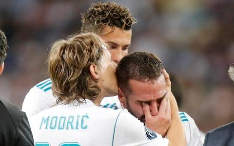Dani Carvajal's Champions League final ends in Injury for the second successive year - Credit: Efrem Lukatsky/AP