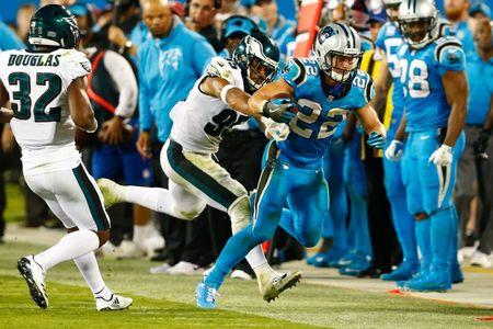 Oct 12, 2017; Charlotte, NC, USA; Carolina Panthers running back Christian McCaffrey (22) gets shoved out of bounds by Philadelphia Eagles outside linebacker Mychal Kendricks (95) in the fourth quarter at Bank of America Stadium. Jeremy Brevard-USA TODAY Sports