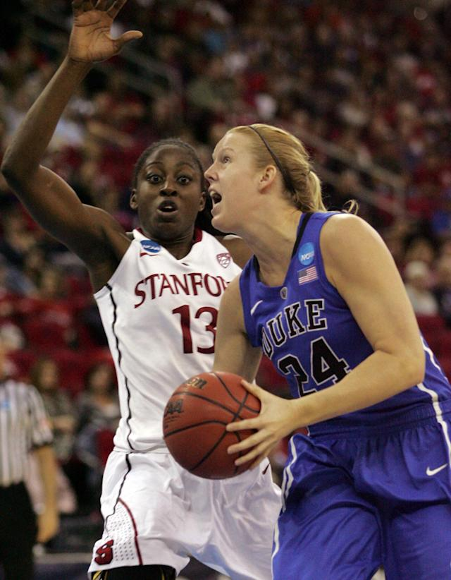 Duke's Kathleen Scheer drives past Stanford's Chiney Ogwumike in the first half of an NCAA women's tournament regional semifinal college basketball game Monday, March 26, in Fresno, Calif. (AP Photo/Gary Kazanjian)