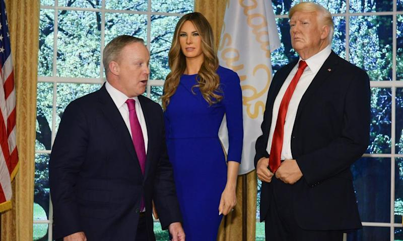 The waxwork of Melania Trump with her husband Donald at the Times Square Tussauds in New York. The real Sean Spicer looks on.