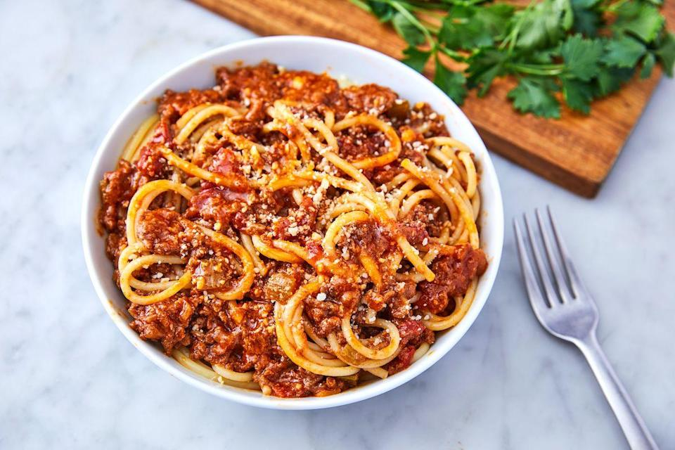 """<p>Bolognese is so much more than just a meat sauce. It's the ultimate way to transform a package of minced beef into something show-stopping. When the temperature starts to drop, what sounds better than pasta smothered in rich, hearty, umami-bomb bolognese? NOTHING.</p><p>Get the <a href=""""https://www.delish.com/uk/cooking/recipes/a29755014/bolognese-sauce-recipe/"""" rel=""""nofollow noopener"""" target=""""_blank"""" data-ylk=""""slk:Bolognese Sauce"""" class=""""link rapid-noclick-resp"""">Bolognese Sauce</a> recipe. </p>"""