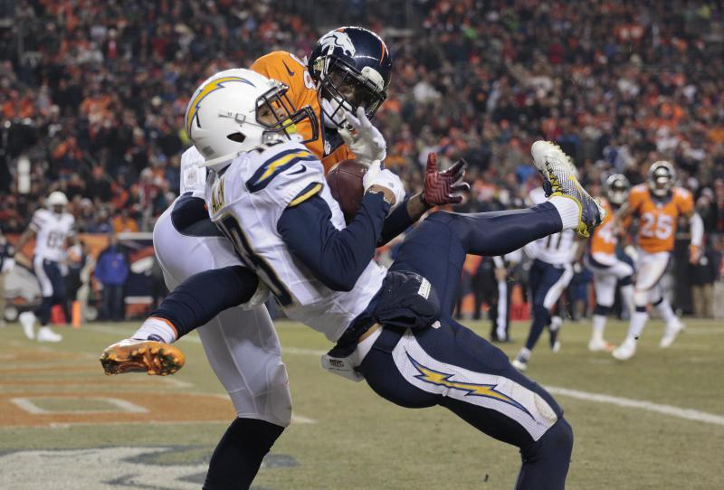 San Diego Chargers wide receiver Keenan Allen (13) catches a pass for a touchdown against Denver Broncos cornerback Kayvon Webster (36) in the second quarter of an NFL football game, Thursday, Dec. 12, 2013, in Denver. (AP Photo/Joe Mahoney)