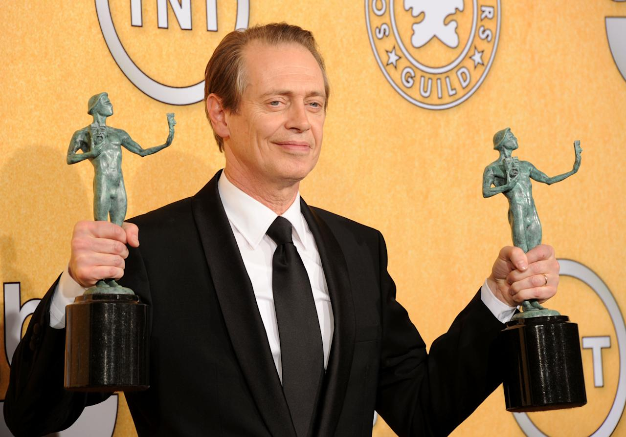 LOS ANGELES, CA - JANUARY 29:  Actor Steve Buscemi poses in the press room with with his Outstanding Performance By A Male Actor In A Drama Series award for 'Boardwalk Empire' during the 18th Annual Screen Actors Guild Awards at The Shrine Auditorium on January 29, 2012 in Los Angeles, California.  (Photo by Jason Merritt/Getty Images)