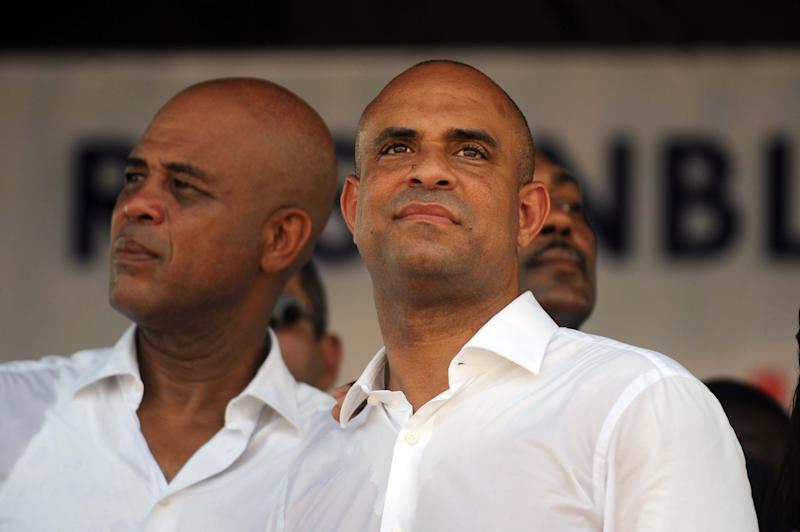 Haitian President Michel Martelli (L) and Prime Minister Laurent Lamothe (R) in Port-au-Prince on October 17, 2014 (AFP Photo/Hector Retamal)