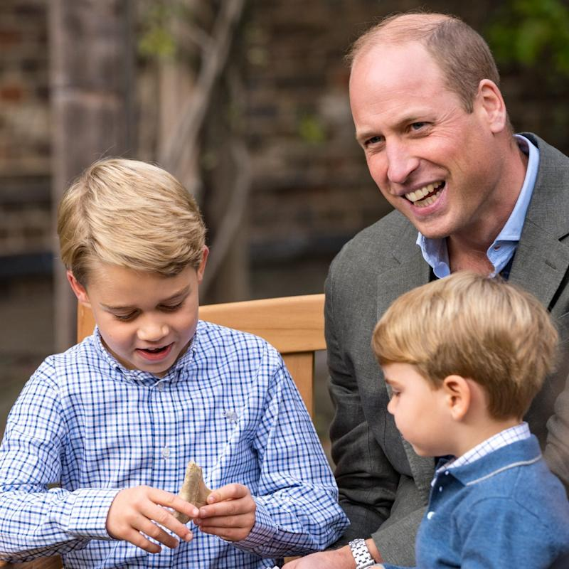 Prince George seemed delighted when he was given the ancient fossil