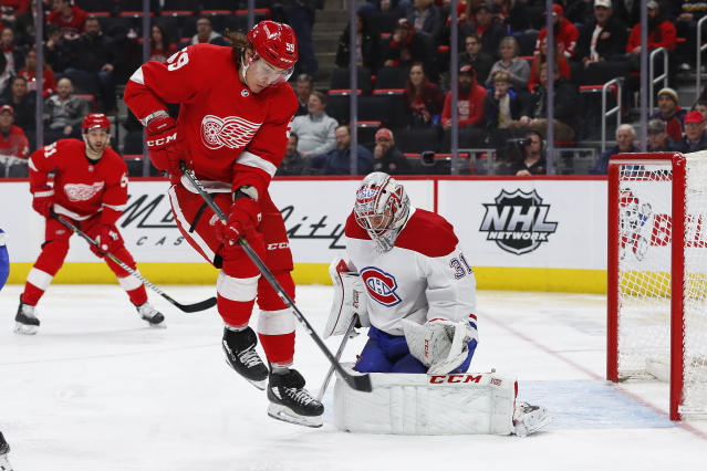 Detroit Red Wings left wing Tyler Bertuzzi (59) jumps in front of Montreal Canadiens goaltender Carey Price (31) who stopped the shot in the second period of an NHL hockey game, Tuesday, Feb. 26, 2019, in Detroit. (AP Photo/Paul Sancya)