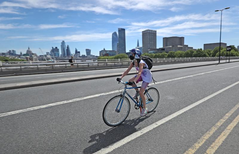 A cyclist on Waterloo Bridge in London, which may be restricted to people walking, cycling and buses only, with pavements widened so people can safely travel between busy railway stations and their workplaces as coronavirus restriction slowly begin to ease. (Photo by Yui Mok/PA Images via Getty Images)